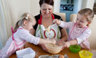 Emma Trappett baking with her four-year-old twins Sienna (left) and Jessica.