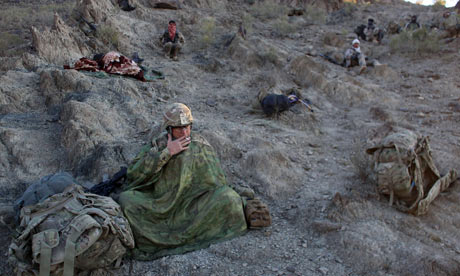 US and Afghan soldiers rest during an operation
