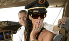 Rihanna in the cockpit of a plane