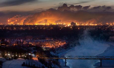 Steam rises from oil refineries over Edmonton in Alberta