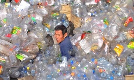 A waste management work sorts plastic bottles