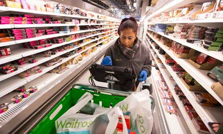 Picker collects items for online shoppers in Waitrose's 'dark' supermarket in west London
