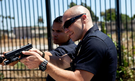 Jake Gyllenhaal and Michael Pena in End of Watch.