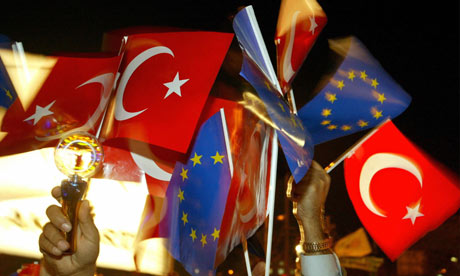 Turkish and EU flags are waved in the air