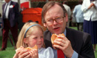 Lord Deben and his four-year old daughter Cordelia eating beefburgers in 1990