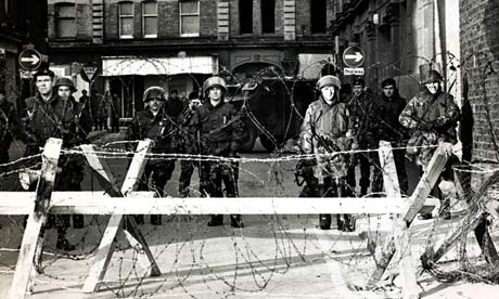 British troops behind a wire barricade in Derry, on Bloody Sunday
