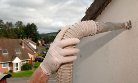 Installing Cavity Wall Insulation in a private house in Bovey Tracey Devon