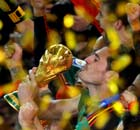 Spain's goalkeeper Iker Casillas kisses the Fifa world cup trophy