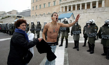 Greece strikes: A protester shouts slogans in front of the Greek Parliament in Athens