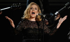 Adele performs during the 54th annual Grammy Awards