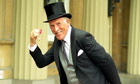 Bruce Forsyth Shows Off His OBE