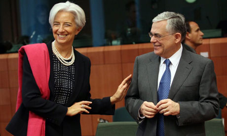 Greek prime minister Lucas Papademos chats with International Monetary Fund chief Christine Lagarde at a Euro Group finance ministers council in Brussels.