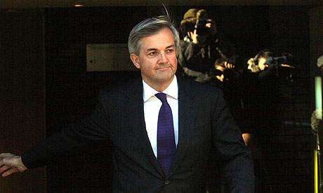 Chris Huhne outside his home in central London to announce he is resigning.