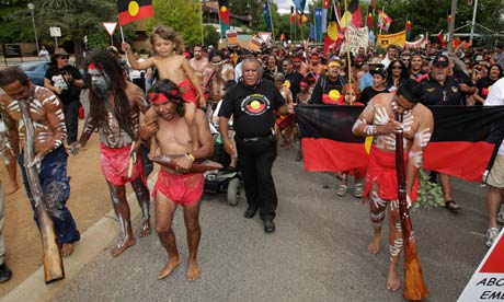 Aboriginal and other protesters interrupt an Australia Day awards ceremony in Canberra.
