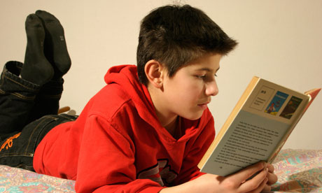 picture of a naked boy reading a book