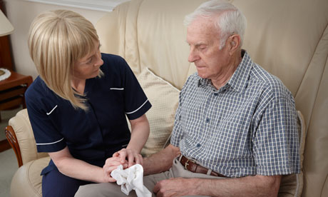 Social care worker with elderly man