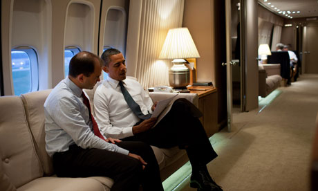 Barack Obama and an advisor on board Air Force One