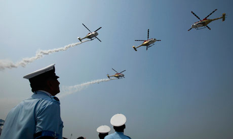 A display by the Sarang helicopter display team during India's air force day at Hindon, New Delhi