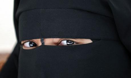 A woman wearing a niqab, or full veil
