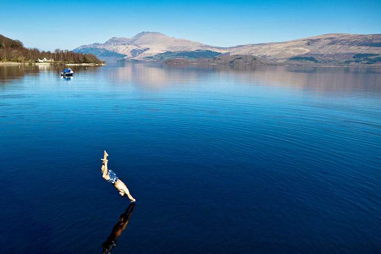 Eyewitness: A swimmer cools off in the spring heat by plunging into Loch Lomond