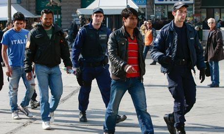 Greek police escort migrants