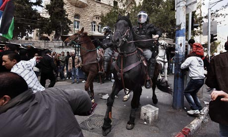 Israeli mounted policemen disperse hundreds of Palestinian protesters during Land Day