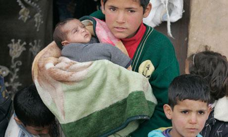 Syrian children refugees arrive into Qaa village, in northern Lebanon