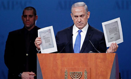 Israeli Prime Minister Benjamin Netanyahu holds copies of 1944 correspondence asking the US war department to bomb the Auschwitz concentration camp Photograph: Chip Somodevilla/Getty Images