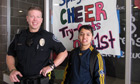 Police officer Jason Moloney and Edgar Aguilar at Springfield high school, Oregon