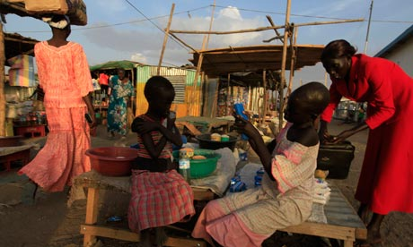 Girls sell biscuits and other groceries at the market in Bor, in Jonglei state, South Sudan