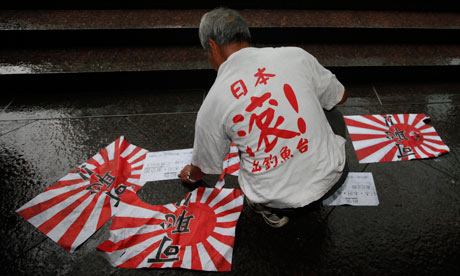 A protester wears a T-shirt with the slogan 'Japan get out of Diaoyu Islands (Senkaku islands)'
