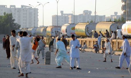 Fuel tanker drivers caught up in the ban on carrying Nato supplies play cricket in Karachi