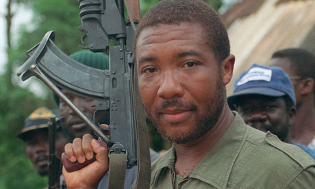 A 1990 photograph of Charles Taylor holding an AK-47 rifle as his rebels marched on Monrovia