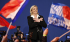 Marine Le Pen celebrates at a Front National rally after the presidential election first round
