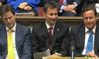 Culture secretary Jeremy Hunt flanked by David Cameron and Nick Clegg in the Commons