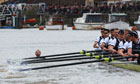 The Oxford crew looks on in alarm as a man swims into their path during the 158th Boat Race