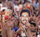 Bahraini anti-government protesters raise images of human rights activist Abdulhadi al-Khawaja