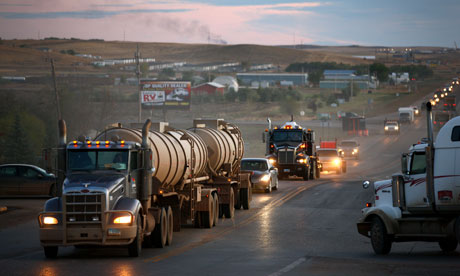 Traffic generated by an oil boom lines the main street in Watford City, North Dakota