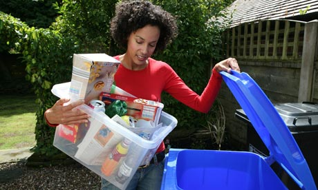 Woman recycles household  008