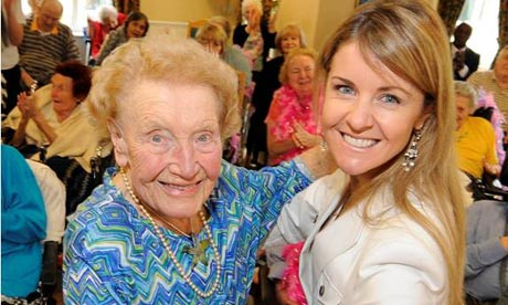 Bupa staff dance with elderly people