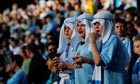 Manchester City fans in sheikh gear, in tribute to their owner.