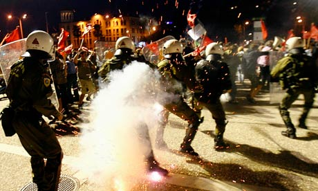Riot police clash with protestors in Thessaloniki, Greece