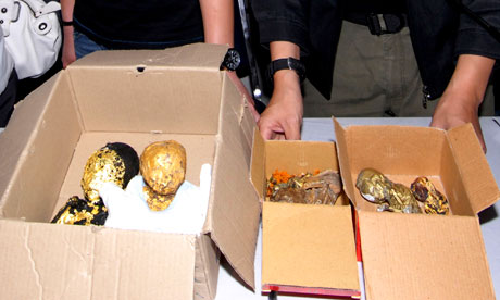 Thai police show the remains of six foetuses wrapped in gold leaf at a news conference in Bangkok.