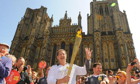 Anthony Deahl carrying the Olympic flame on the leg between Wells and Shepton Mallet
