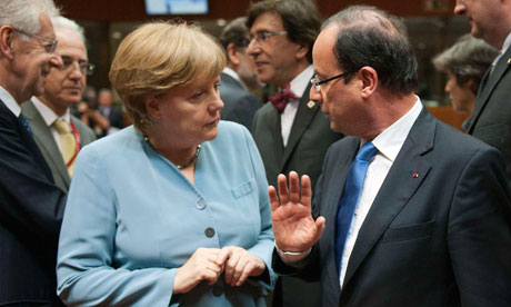 Eurozone crisis: Germany and France clash over eurobonds at summit  French president Franois Hollande marks his Brussels debut by challenging chancellor Angela Merkel over bailout