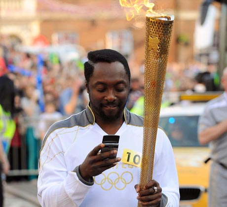 Will.I.Am carries the Oly 001 8 reasons why will.i.am is the worst musician of our time