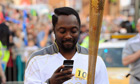 Will.I.Am carries the Olympic torch through Taunton, May 2012