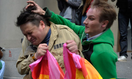 Russian Orthodox church activist attacks a gay rights proteste