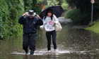 People wade through flood water near Chichester