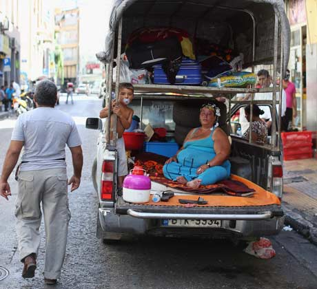 A family living in a pickup truck in Athens, June 2012